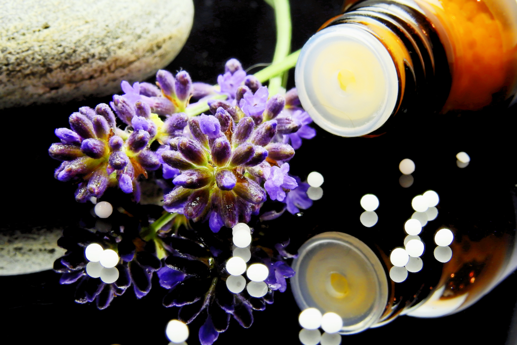 Homeopathy treatment next to flower